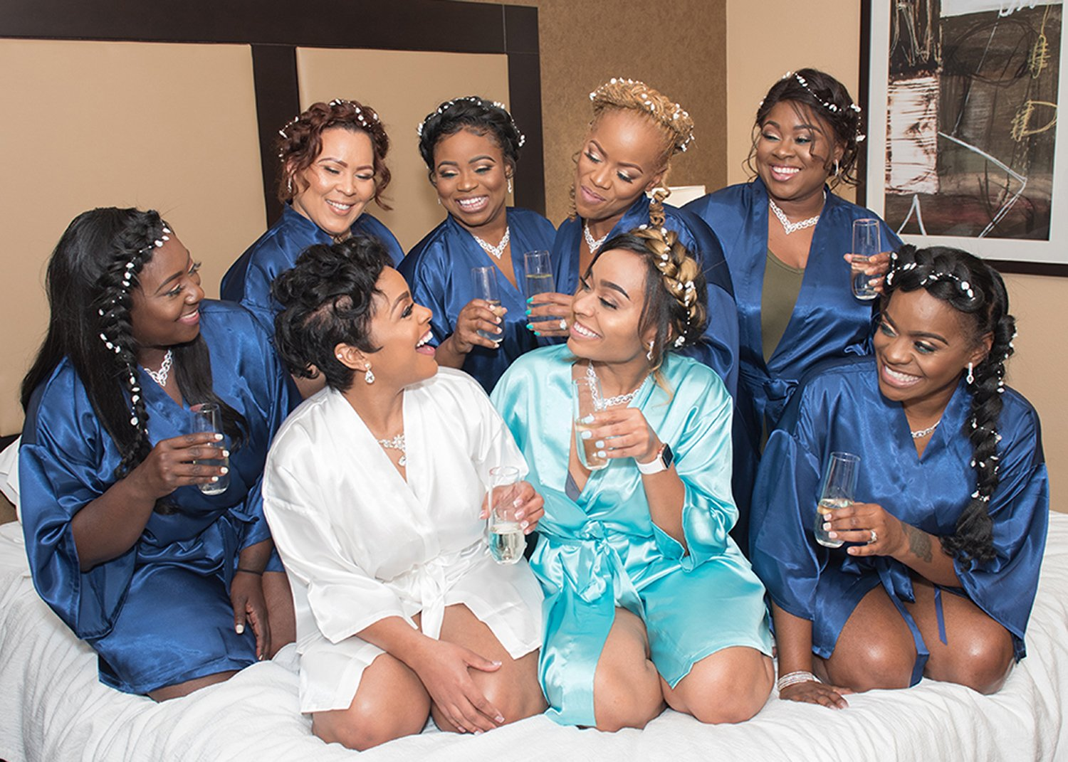 bridal party wearing robes laughing