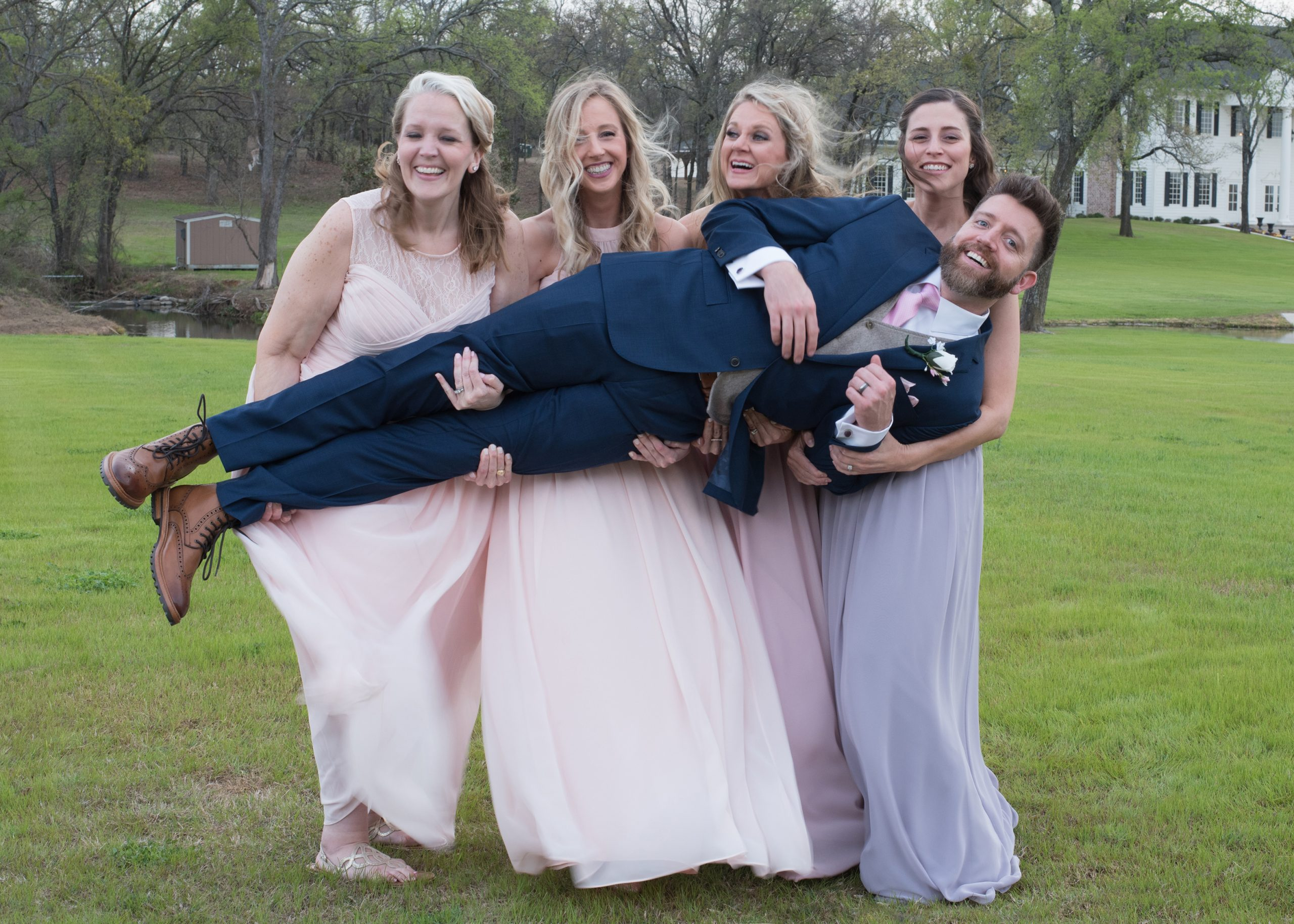 bridal party holding groom