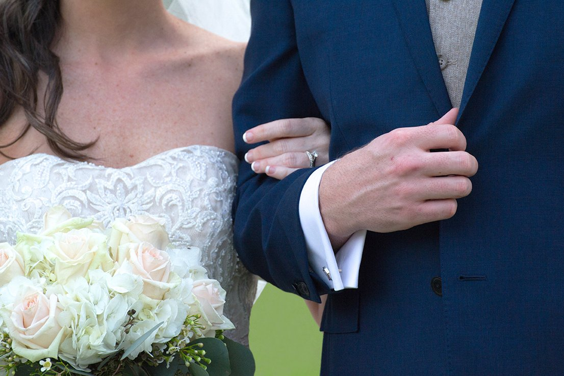 bride holding groom's arm