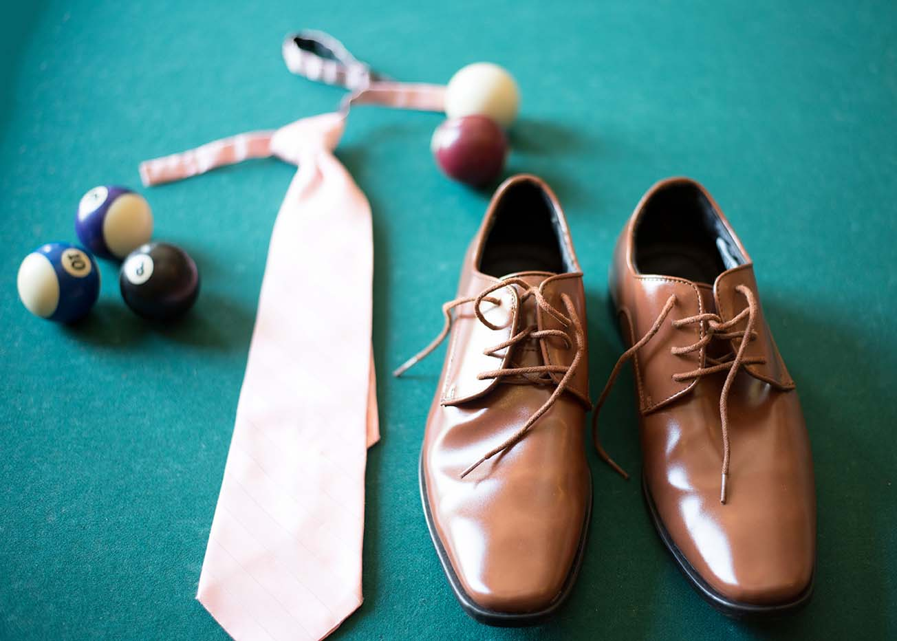 grooms shoes and tie on pool table