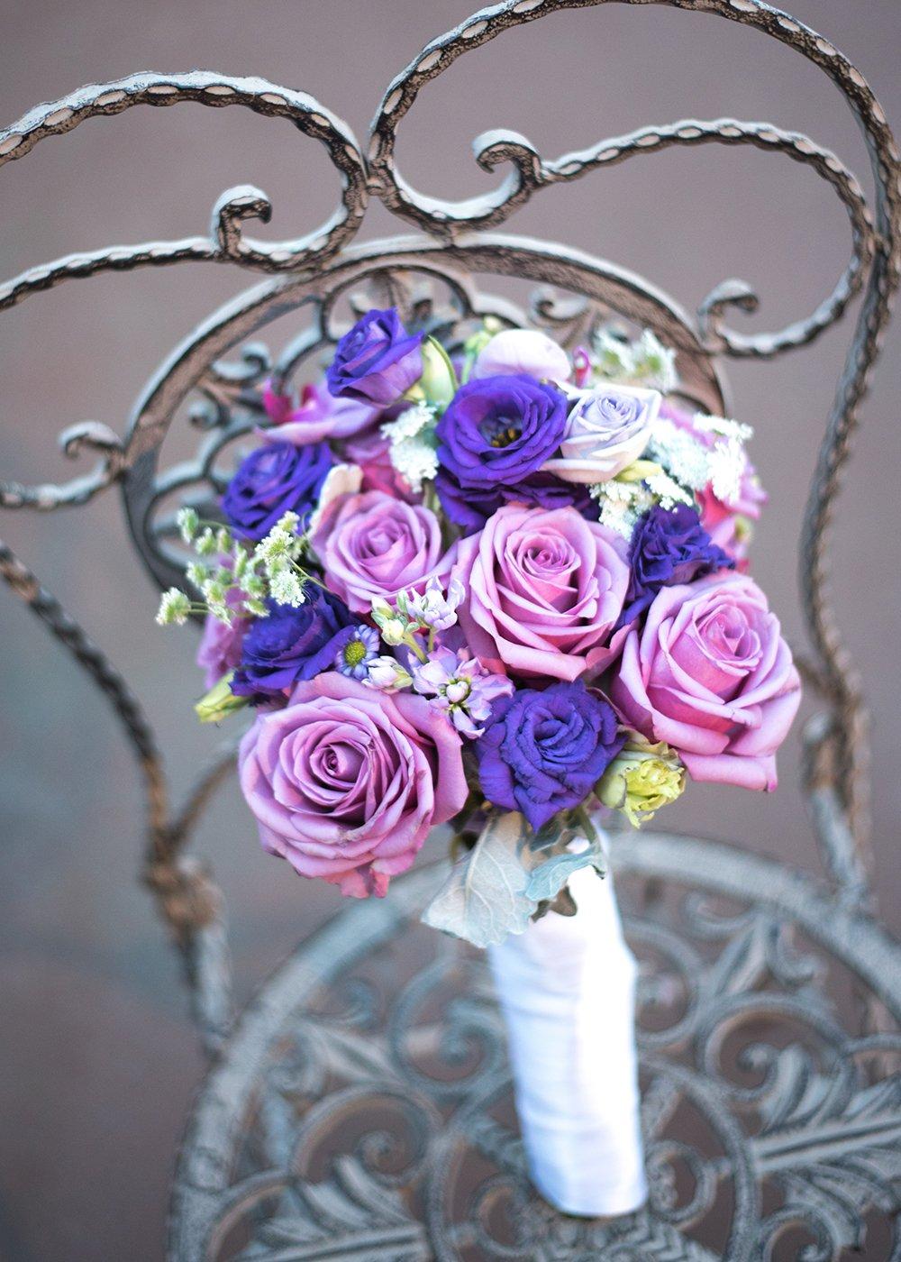 purple wedding bouquet in iron chair