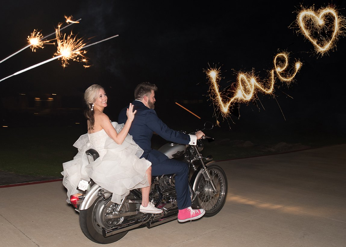 bride and groom leaving wedding on a motorcycle
