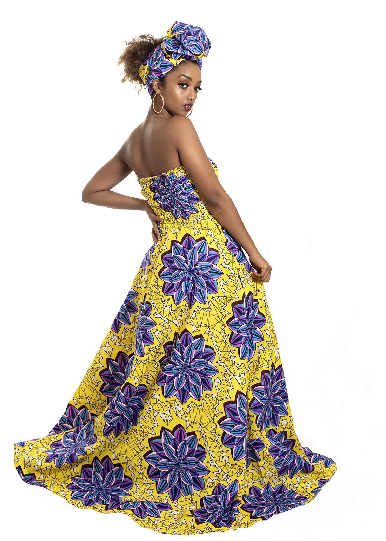 woman wearing yellow dress with purple flowers