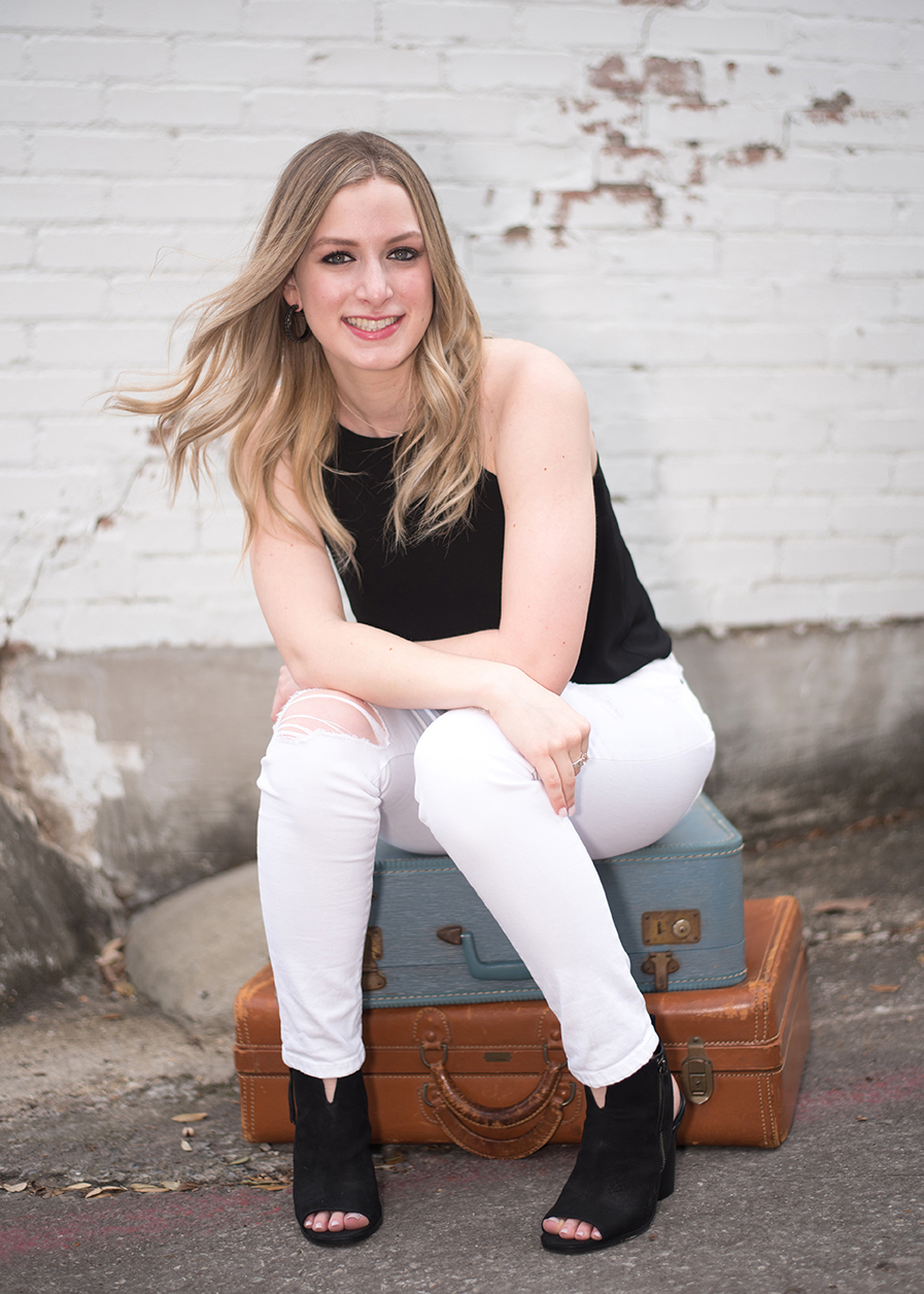girl sitting on suite cases in McKinney Texas