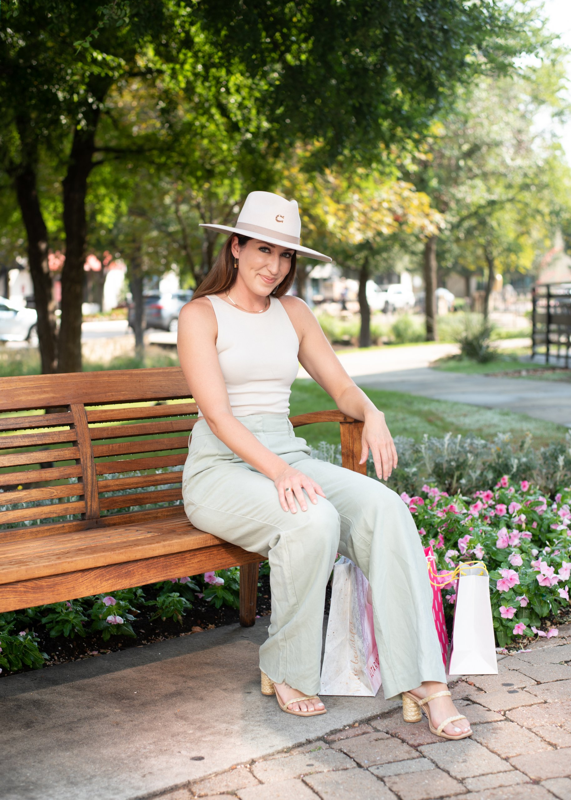 girl sitting on a bench at watters creek