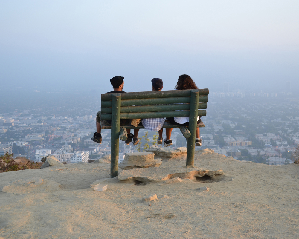 three friends sitting on bench in Los Angeles