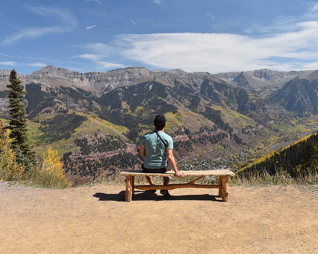 man sitting on a bench Telluride Colorado